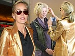 I love your hair! Sharon Stone snaps pictures with her phone of a beautiful stranger at the airport