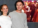 Fanning the flames of passion! Nicholas Hoult and Jennifer Lawrence are caught together at Hunger Games: Catching Fire premiere