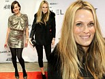 Molly Sims covers up in bulky coat while fellow model Milla Jovovich shows off her slender frame in gold frock at H&M event