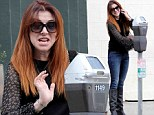Clearly not as easy as pie! Make up free Alyson Hannigan scowls as she struggles with a parking meter