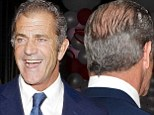 Mel Gibson tries and fails to disguise his large bald patch as he leaves Hollywood event