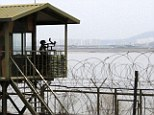 A South Korean soldier mans the border with North Korea, where reports have emerged of 80 people being publicly executed
