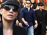 That's amore! Jennifer Lopez and Casper Smart hold hands as they stroll through Rome squashing rumours they're on the rocks