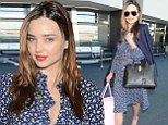 Show off my bra? Who me? Never! Miranda Kerr opts for a consciously demure look as her former Angels colleagues flash the flesh