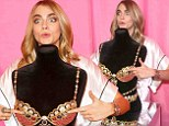 It's not your turn yet! Cara Delevingne can't resist checking out the $10m Victoria's Secret Fantasy Bra