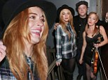 Lindsay Lohan is Like A Rolling Stone as she sings along to Bob Dylan hits at festival... then meets musicians backstage