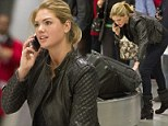 No diva here! Kate Upton may be the modelling world's newest star but she's not too big to carry her own bags