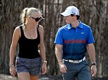 Back together: Tennis star Caroline Wozniacki and Rory McIlroy after the first round of the DP World Tour Championship