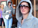 Must have been a killer workout! Pink-faced Anne Hathaway wears VERY tight leggings as she leaves a dance studio