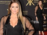 Khloe Takes London: The youngest Kardashian shrugs off marriage troubles as she shows off her curves in lacy jumpsuit