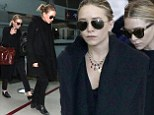 Mary-Kate and Ashley Olsen in identical outfits