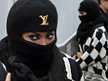 There's no disguising those peepers! Beyonce tries to sneak out of LA studio in burka-style head gear