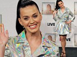 Katy Perry wears overly shiny foil-style biker jacket and matching pleated skirt for German radio performance