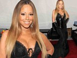 Gay icon Mariah Carey barely contains her ample assets in plunging corset as she shows her support at annual Out100 Gala