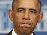 President Barack Obama pauses while speaking about his signature health care law, Thursday, Nov. 14, 2013