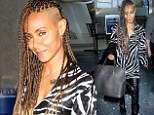 Taking a walk on the wild side! Jada Pinkett Smith teams her long braided mane with zebra-print top as she touches down at LAX