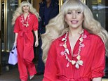 Lady In Red: Gaga heads to SNL rehearsal... but looks more Saturday Night Fever in flared red outfit