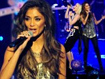 It's a cover up! Nicole Scherzinger does demure in metallic top and leggings as she performs at the Global Angel Awards
