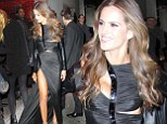 Izabel Goulart has a fashion fail as her sexy split dress gets caught under someone's heel at Victoria's Secret show after party