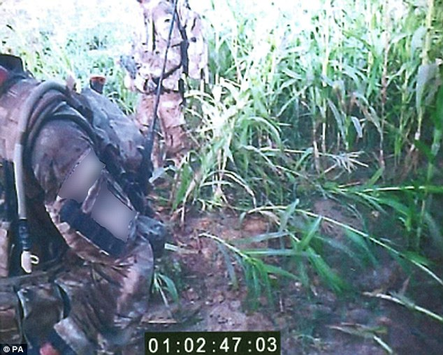 Footage: The recording hears the group dragging the man's injured body with the marines apparently joking about refusing to give first aid