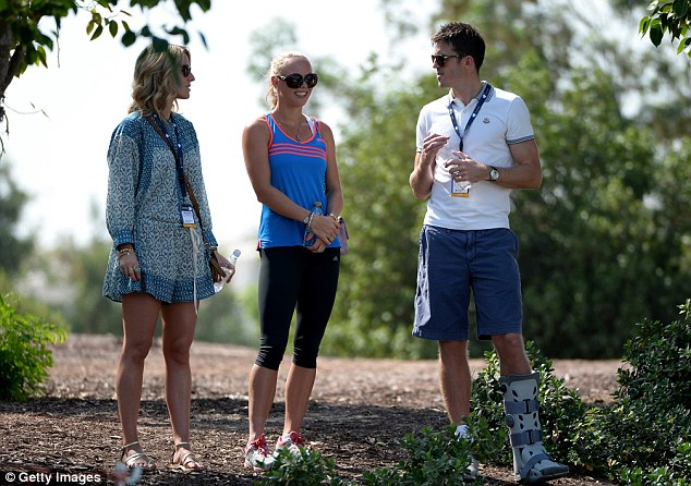 Relaxing: Michael Carrick watches Rory McIlory with the golfer's girlfriend Caroline Wozniacki (centre)