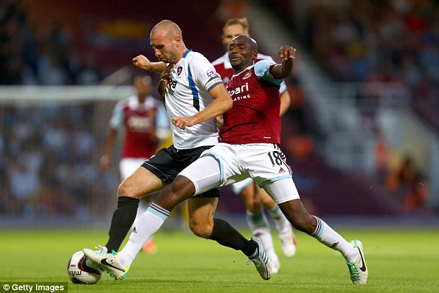Out: Alou Diarra (right) was injured during West Ham's Capital One Cup against Cheltenham Town