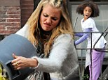 It's The Hard-Knock Life! 'Mean Miss Hannigan' Cameron Diaz spills rubbish while 'little orphan' Quvenzhane Wallis sings and sweeps on set of Annie