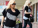 It's a cover up! Pregnant rocker Gwen Stefani continues to hide growing baby bump with loose-fitting grey and black tunic