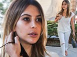 Baby keeping you up Kim? Kardashian can't conceal the dark circles under her eyes as she steps out in ripped jeans for lunch with gal pal