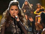 Worth the wait! Selena Gomez takes to the X Factor stage in a racy leather ensemble for rescheduled performance of new hit single Slow Down