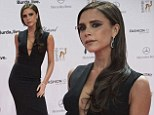 Smoky gets in your eyes: Victoria Beckham goes overboard with the eyeliner as she arrives at Bambi Awards in black maxi