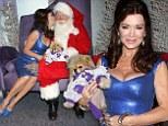 Nice Vanderpup! Santa admire Lisa's pooch as she kisses him at Christmas pet portrait event