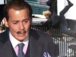 Action man Johnny Depp gets hit by a car (but don't worry, it's just a scene for his new movie)