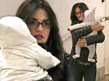 Baby's first shopping trip! Penelope Cruz holds little Luna close to her chest as they leave London department store
