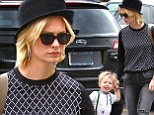 The apple doesn't fall far from the tree! Stylish January Jones dresses her growing son Xander in hipster-style ensemble complete with tiny braces