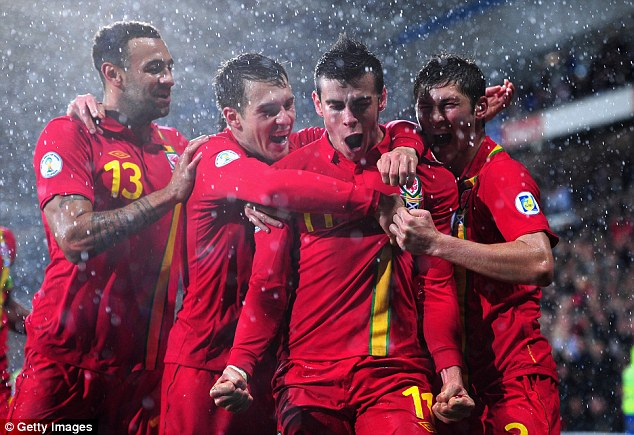 Enter the Dragon: Gareth Bale (2nd left) is confident that Wales can qualify for Euro 2016