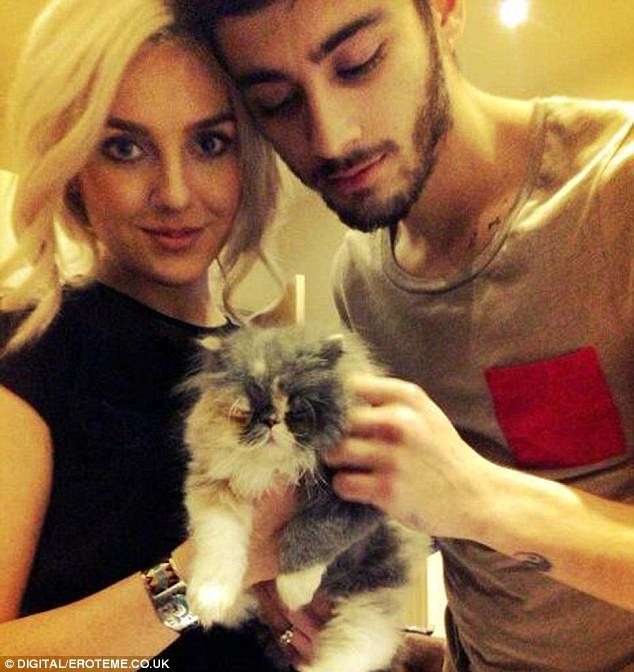 Family: Perrie tweeted this photo of herself, Zayn and their new kitten, saying 'Say hello to the new member of the family, Prada :) Perrie&Zayn <3'
