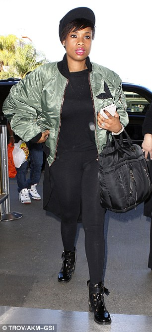 Winning ensemble: The 32-year-old actress paired her skintight leggings with a black top and green jacket embellished with wings