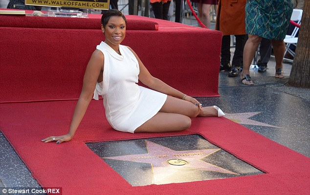 Pavement pose, no problem: Even with that short hemline, Jennifer had no trouble posing on the ground beside her shining new star