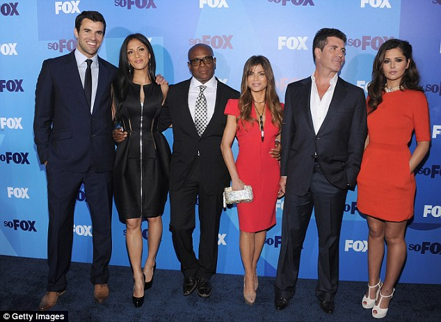 New venture: Cowell and his original X Factor USA hosting and judging line-up. The beleaguered show is now set to face the axe following a drop in viewing figures