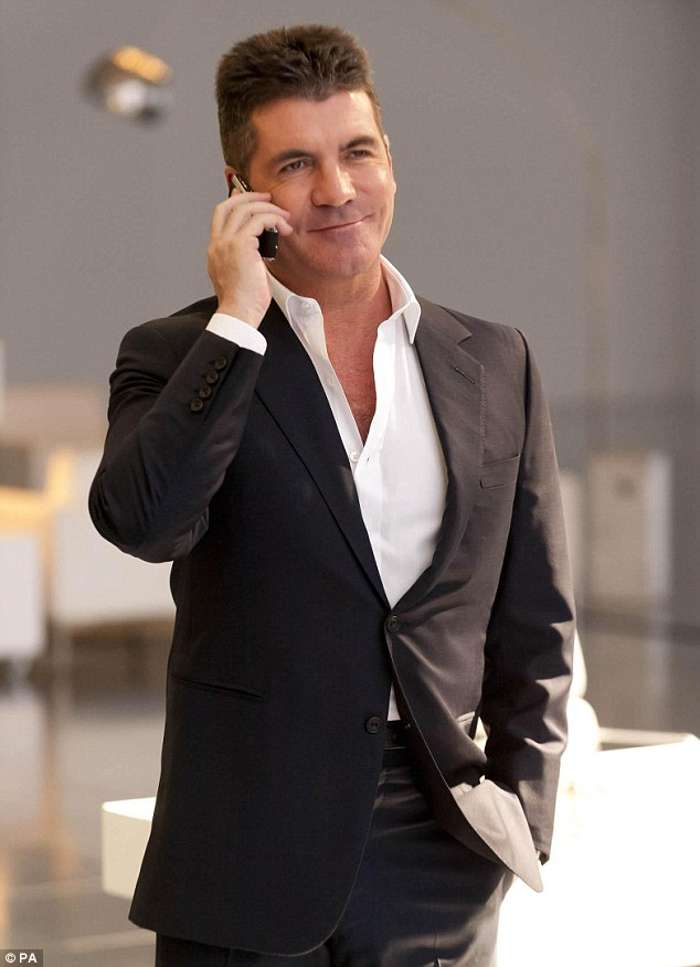 The cat who got the cream: Cowell's new deal could net him £15 million