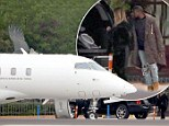 Living the high life! Kim Kardashian and Kanye West are stylish travellers as they prepare to jet out of Los Angeles