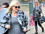 No slowing down yet! Pregnant Gwen Stefani is an attentive soccer mum as she disguises her bump in camouflage at Kingston's match