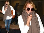 Hello sunshine! Emma Stone grins as she touches down in warm Los Angeles after escaping the glacial east coast