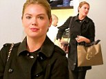 Kate Upton hides her famous figure for shopping trip