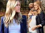 She's starting to show! Kristin Cavallari displays her brand new baby bump as she takes pooch Brando out for a stroll