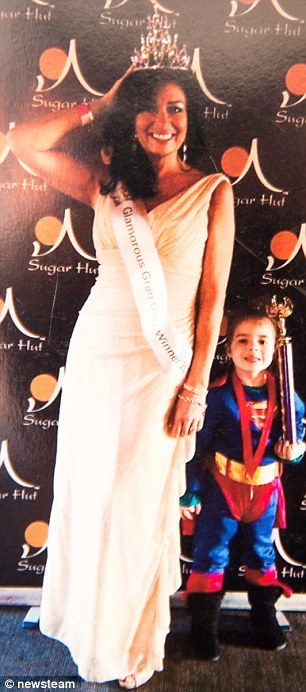 Winner: Annemarie poses with her granddaughter Mynah after being crowned the UK's most glamorous gran