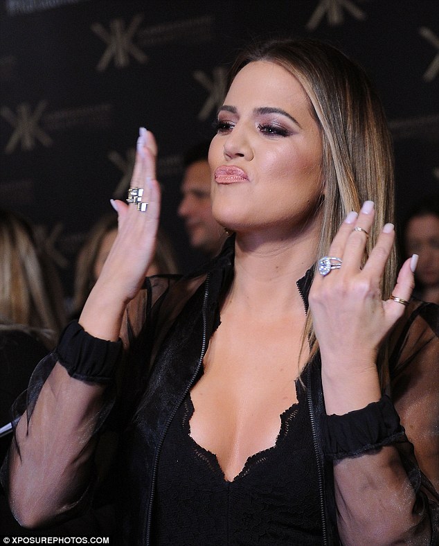 Hostess with the mostess: Khloe modeled the clothing from the new Kardashian Kollection being launched at the Natural History Museum on Thursday night