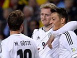 On the offensive: Andre Schurrle (second right) celebrates with German team-mates Mesut Ozil (right) and Mario Gotze during their 5-3 win in Sweden