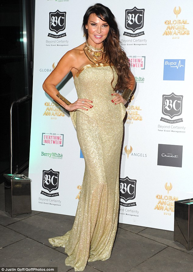 Golden girl: TV presenter Lizzie Cundy looked fabulous in a gold Pia Michi gown